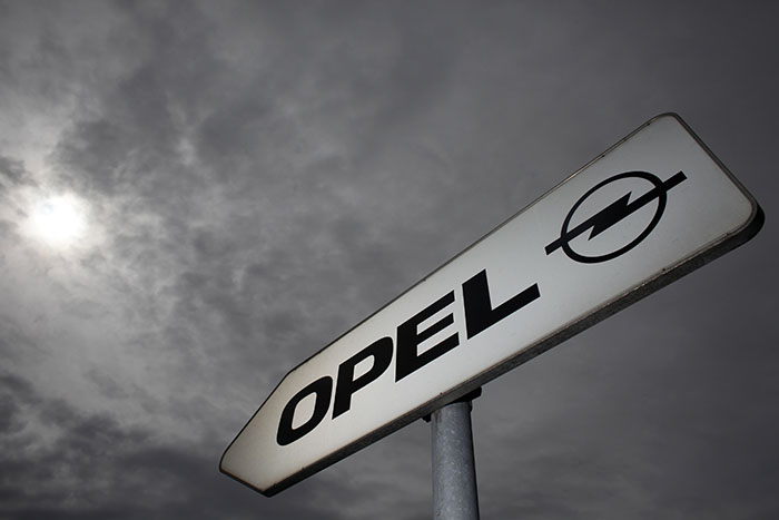 A traffic sign shows the way to the Opel plant in Ruesselsheim
